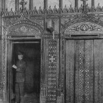 The Cathedral Of Commerce - black and white image showing an elevators inside of the Woolworth building that take you up the Observation Gallery, also showing a man who is holding the elevator waiting for passengers to take on it, New York, New York, 1917. (Photo by Museum of Science and Industry, Chicago/Getty Images)